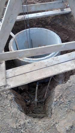 Углубление колодца стандартными (метровыми) кольцами